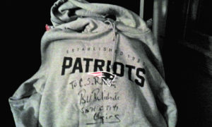 New England Patriots gray hoodie sweatshirt autographed by Patriots Head Coach Bill Belichick especially for CSRNE. Size: XL. All of the Patriots Superbowl wins listed on it by Bill himself.