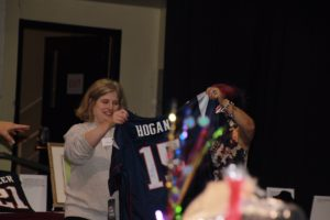 Elaine shows signed Patriots jersey